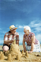Senior_couple_sandcastle