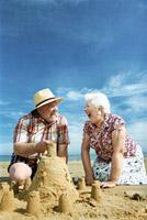 Senior_couple_sandcastle